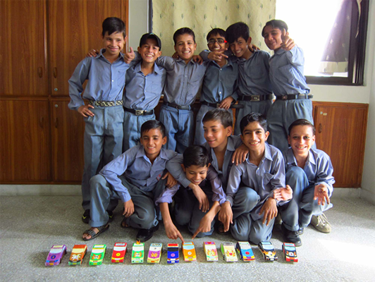 Behbod boys posing with their car constructions