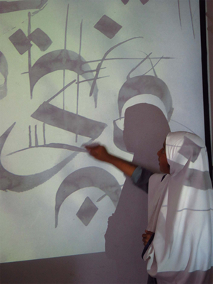 Student interacting with an art projection