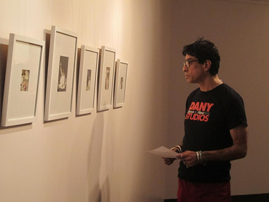 Artist Ameen Gulgee observing displayed work
