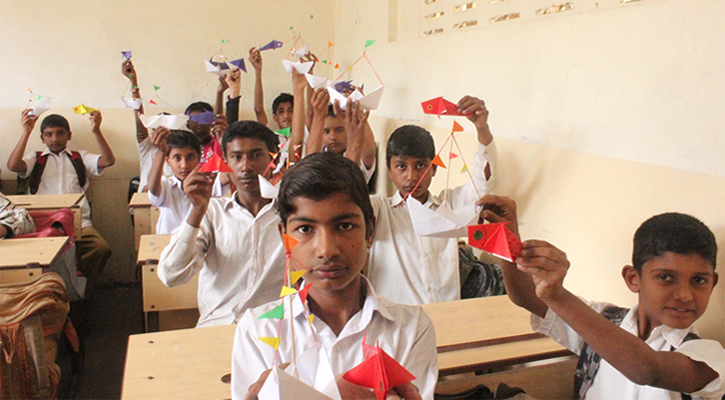 Students with their decorative paper boats