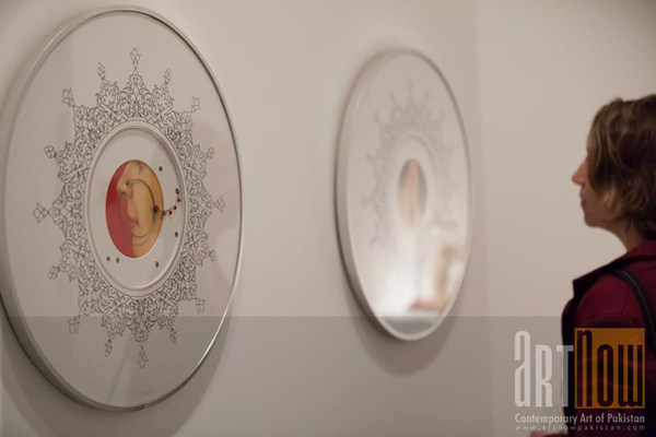 Viewer observing displayed work at gallery, photograph by Art Now Online