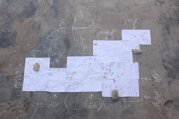 Drawing the map, closeup of the drawing assemblage